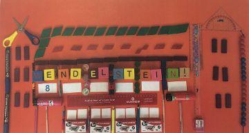 Kreative Darstellung der Grundschule mit Gegenständen